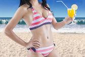 Woman wearing sexy bikini with fresh drink — Stock Photo
