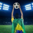 Brazilian supporter holding a ball at field — Stock Photo #47280193