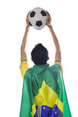 Brazilian supporter holding a ball isolated — Stockfoto