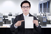 Businessman showing empty placard — Stock Photo