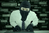 Businessman wearing mask stealing data — Stock Photo
