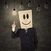 Affärsman med smiley smiley med idén — Stockfoto