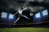 Football player kicking ball — Stock Photo