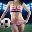 Soccer fan wearing bikini and holding ball — Stock Photo #47303369