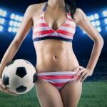 Soccer fan wearing bikini and holding ball — Stock Photo