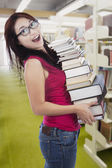 Student borrow many books in library — Stockfoto