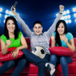 Ecstatic soccer fans watching tv — Stock Photo #47999155