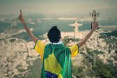 Brazilian supporter holding a trophy — Stock Photo