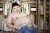 Fat man with his old jeans — Stock Photo