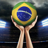 Hands holding soccer ball 2 — Stock Photo