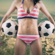 Sexy soccer fan holding two balls — Stock Photo #48011863