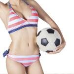 Woman wearing bikini holding a ball — Stock Photo