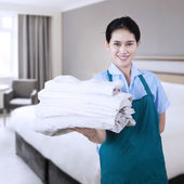 Maid hotel in the hotel room — Stock Photo