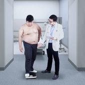 Measuring body weight — Stock Photo