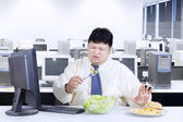 Overweight businessman avoid junk food — Stock Photo