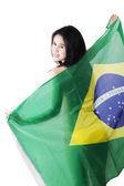 Sexy model holding brazilian flag — Stock Photo