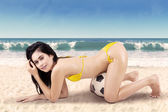 Sexy woman with soccer ball on vacation 2 — Stock Photo