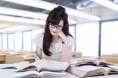 Beautiful student doing homework — Stock Photo