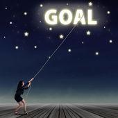 Businesswoman taking her goal from the sky — Zdjęcie stockowe
