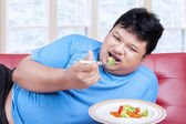 Man try to diet by eating vegetable 1 — Stock Photo