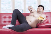 Obese man eats fast food 1 — Foto de Stock