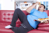 Obese person bite a slice of pizza 1 — Stock Photo