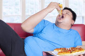Obese person eats pizza 1 — Stock Photo