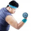 Overweight man exercising with dumbbell 1 — Stock Photo #49190039