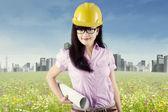 Pretty engineer holding blueprint 1 — Stock Photo