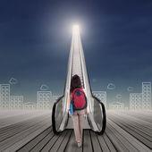 Student walking toward sky — Stock Photo