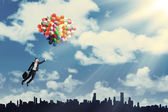 Woman flying with balloons to get her dream 1 — Photo