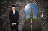 Asian businessman standing in front of keyhole — Stock Photo