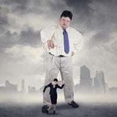 Businessman controlling his subordinate — Stock Photo