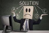 Businessman doubt to choose the solution — Stock Photo