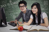 Cheerful young students in class 1 — Stock Photo