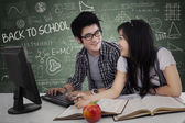 Cheerful young students in class — Stock Photo