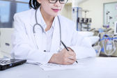 Doctor Writes A Note — Stock Photo