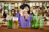 Drunk man in the bar — Stock Photo