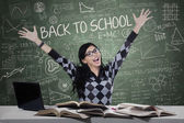 Excited female student in the classroom — Stock Photo