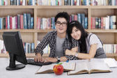 Lovely two student in library 1 — Stock Photo