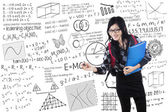 Student writes formula on whiteboard — Stock Photo