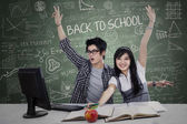 Successful students winning in class — Stock Photo