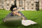 Thoughtful student in the park — Stock Photo