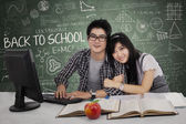 Young couple in class — Stock Photo