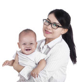 Asian businesswoman and her baby — Stock Photo