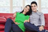 Asian couple smiling at camera — Stock Photo