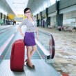 Businesswoman standing on escalator 2 — Stock Photo