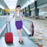 Businesswoman standing on escalator — Stock Photo #50573281