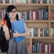 Female high school student in library — Stock Photo