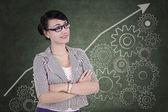 Businesswoman with gear mechanisms — Stock Photo